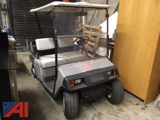 (1) EZ-GO Electric Golf Cart, (6) Batteries, (1) Charging Station