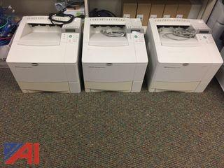 (3)  HP 4100 Printers, (3)  Universal Paper Trays & Toner