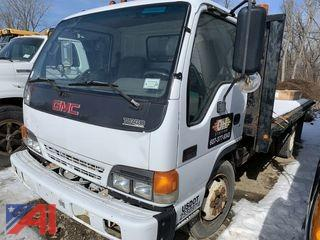 2002 GMC W55042 Tilt Cab Flatbed Truck