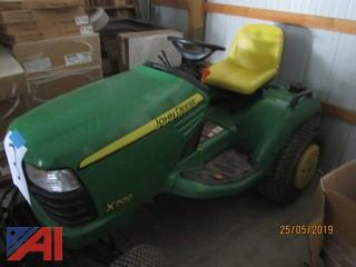 John Deere X700 Ultimate Tractor with Plow Attachment