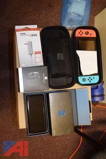 Galaxy S9 Phone, Nintendo Game System, and Nintendo 3DS Charger
