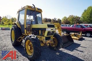 1991 Case/IH 595AXL Utility Tractor with Loader and Attachments
