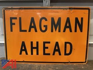 Flagman Ahead Road Sign