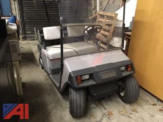 (1) EZ-GO Electric Golf Cart, (6) Batteries, (1) Charging Station