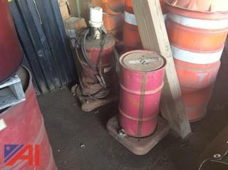 Air Grease Unit and Barrels of Grease