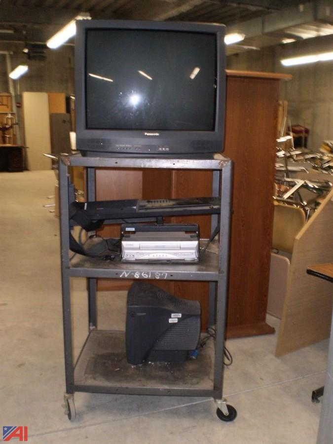 tube tv on a metal cart with a vcr