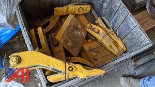 Crate of Loader Bucket Teeth and Cutting Edge End Pieces