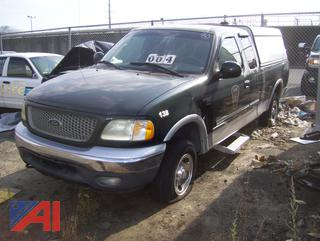 2002 Ford F150 Extended Cab Pickup Truck with Cap